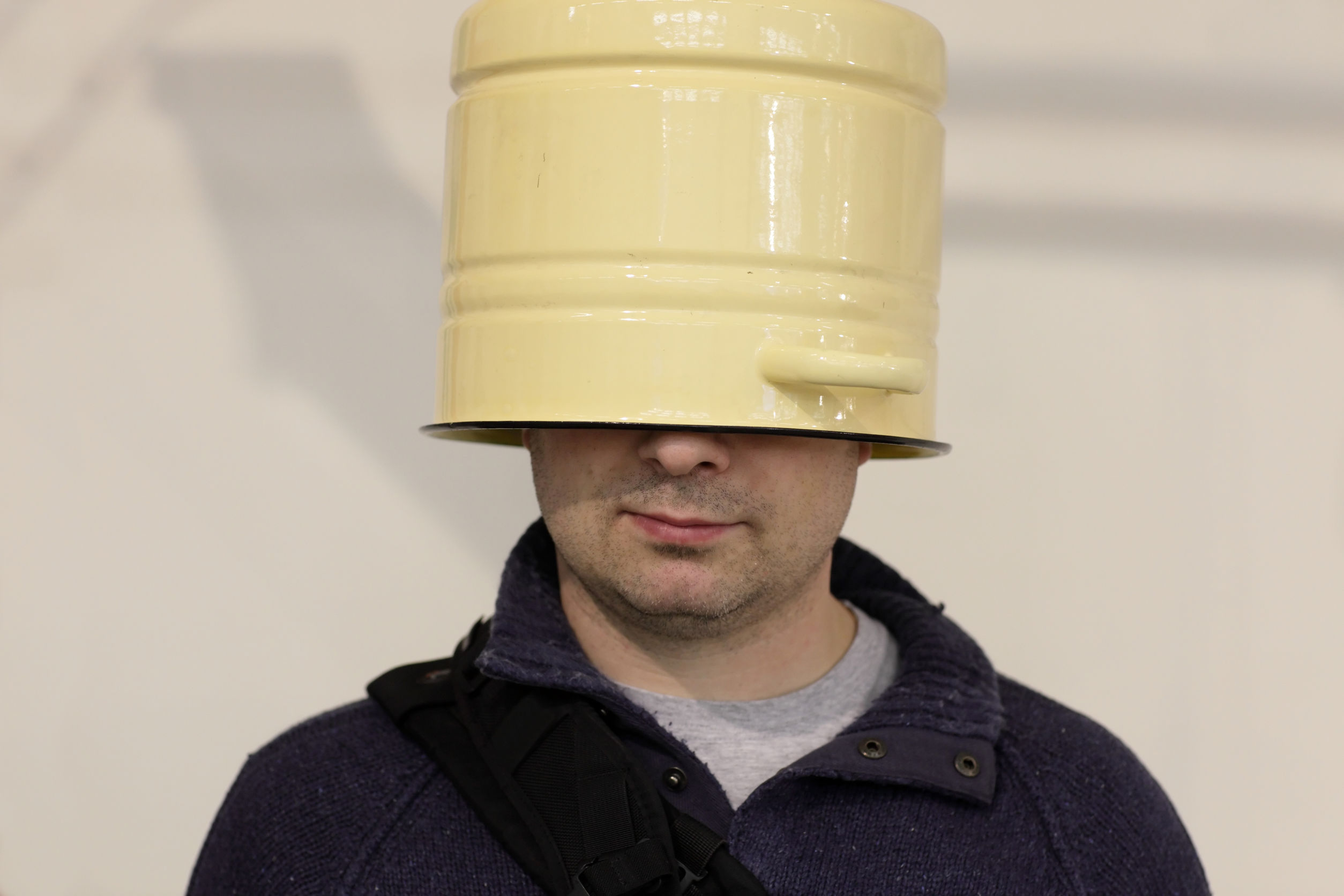 25449118 - the blinkered man with a bucket on his head